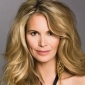Claudia Foster played by Elle Macpherson