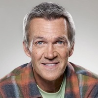 Fred played by Neil Flynn