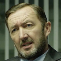 Adam Radford played by Ralph Ineson