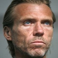 Conrad Harlow played by Richard Brake