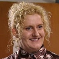 Regina Butcher played by Celia Ireland
