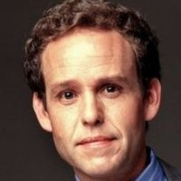 John 'The Biscuit' Cage played by Peter MacNicol