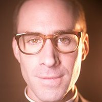 Monsignor Timothy Howard played by Joseph Fiennes