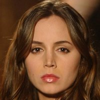 Faith played by Eliza Dushku