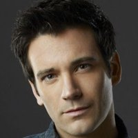 Tommy Merlyn played by Colin Donnell