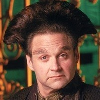 Vir Cotto played by Stephen Furst