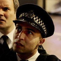 TSG Officer Robbie played by Adam Deacon