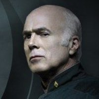 Colonel Saul Tigh played by Michael Hogan