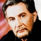 Father - Jacob Wellsplayed by Roy Dotrice