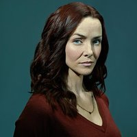 Julia Brasher played by Annie Wersching