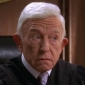 Judge Clark Brown played by Henry Gibson