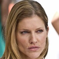 Carla Baxter played by Tricia Helfer