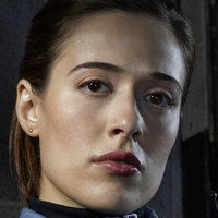 Officer Kim Burgess played by Marina Squerciati