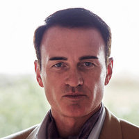 Rupert Boyce played by Julian McMahon
