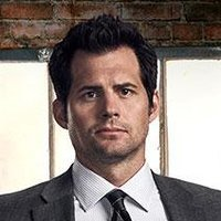 Sam Barber played by Kristoffer Polaha