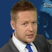 Weather Presenter played by Tomasz Schafernaker