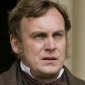 Mr. Carter played by Philip Glenister