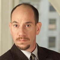 Dr. Garret Macy played by Miguel Ferrer