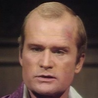 Roger Collins played by Louis Edmonds