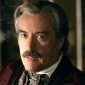Cy Tolliver played by Powers Boothe