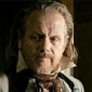 E.B. Farnum played by William Sanderson