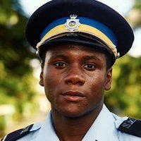 Officer J.P. Hooper played by Tobi Bakare