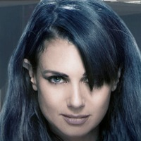 Kenya played by Mia Kirshner Image
