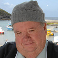 Bert Large played by Ian McNeice