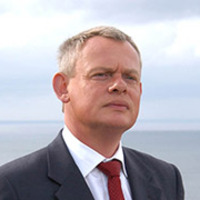 Dr. Martin Ellingham played by Martin Clunes