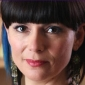 Dr. Georgina Woodson played by Stirling Gallacher