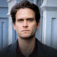 Billy played by Steven Pasquale