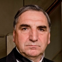 Mr Carson played by Jim Carter
