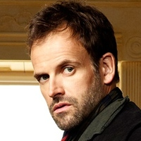 Sherlock Holmesplayed by Jonny Lee Miller