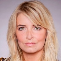 Charity Sharma played by Emma Atkins