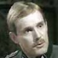 Standartenfuhrer Grunwald played by Clive Francis