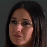 Sloan McQuewick played by Emmanuelle Chriqui
