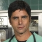 Dr. Tony Gates played by John Stamos Image