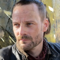 Tector played by Ryan Robbins