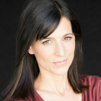 Nina Devon played by Perrey Reeves