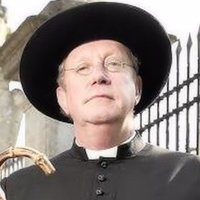 Father Brown played by Mark Williams
