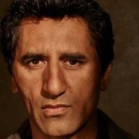 Travis Manawa played by Cliff Curtis
