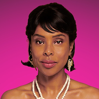 Caroline played by Sophie Okonedo Image