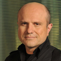 Sgt. Gregory Parker played by Enrico Colantoni