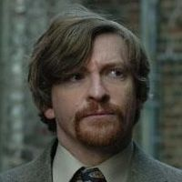 Murray Hewitt played by Rhys Darby