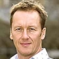 Football Pundit played by Lee Dixon
