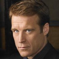 John Scott played by Mark Valley