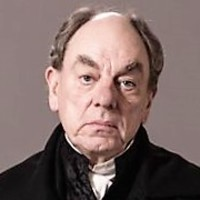 Lord Bentonplayed by Alun Armstrong