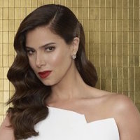 Gigi Mendoza played by Roselyn Sanchez