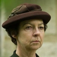 Mrs. Maguire played by Tessa Peake-Jones