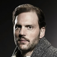Munroe played by Silas Weir Mitchell